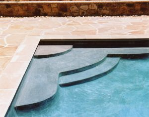 cantilever coping and bullnose coping on a luxury inground pool