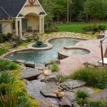 custom inground pool with poolhouse