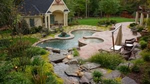 custom inground pool with poolhouse